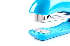 Blue stapler isolated on white background. School stationery royalty free stock images