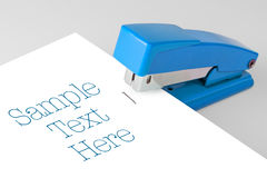 Blue Stapler Lies Royalty Free Stock Image
