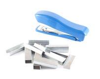 Blue stapler with staples Stock Photo