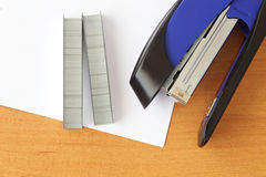 Blue stapler and staples with paper Stock Photo
