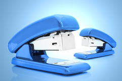 Blue staplers Stock Images