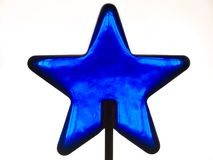 Blue star. Blue isolatet glass star on a stand stock photos