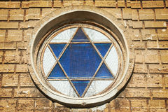 Blue star of David in the window Royalty Free Stock Photography