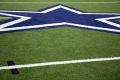 Blue star on a football field background  Royalty Free Stock Photos