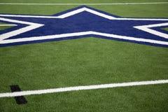 Blue star on a football field Royalty Free Stock Photos