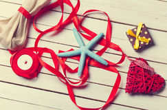Blue star, red ribbons and little gifts lying on the table Stock Images