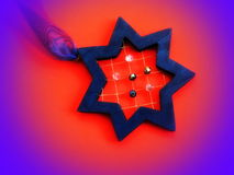 Blue star with ribbon and beads. Christmas decoration stock photography