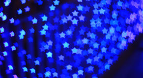 Blue star shape light bokeh background Royalty Free Stock Image