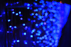 Blue star shape light bokeh background Stock Photography