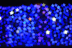 Blue star shape light bokeh background Stock Images