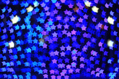 Blue star shape light bokeh background Royalty Free Stock Photos