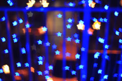 Blue star shape light bokeh background Royalty Free Stock Photo
