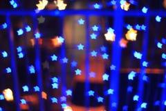 Blue star shape light bokeh background Royalty Free Stock Photo