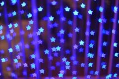 Blue star shape light bokeh background Royalty Free Stock Images