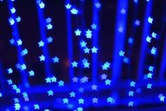 Blue star shape light bokeh background Stock Photos