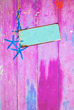 Blue starfish and space on pink Royalty Free Stock Image