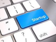 Blue startup button on keyboard - start up concept Royalty Free Stock Images