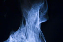 Blue Steam. Steam gently rising, swirling, lit by sun light Stock Photo