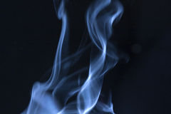 Blue Steam C. Steam gently rising, swirling, lit by sun light Royalty Free Stock Image