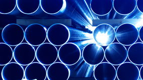 Blue Steel. Industrial Produced Pile of Steel Pipes Closeup in Blue Stock Photos