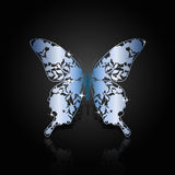 Blue steel abstract butterfly on black background Royalty Free Stock Images