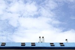 Blue steel roof skylight windown chimney sky Royalty Free Stock Image