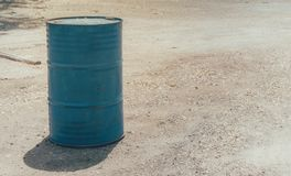 The blue steel tank on the ground for keep water or oil. Royalty Free Stock Photography