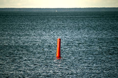 Blue steel water with red buoy Royalty Free Stock Photo