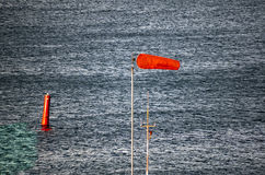 Blue steel water with red buoy and airtube Royalty Free Stock Photos