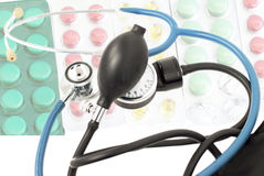 Blue stethoscope against the background of different tablets Royalty Free Stock Image