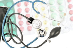 Blue stethoscope against the background of different tablets Royalty Free Stock Photography