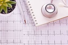 Blue stethoscope and cardiogram pulse trace concept. For cardiovascular medical exam. Medical and health concept Royalty Free Stock Photos