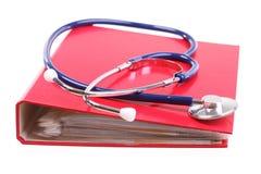 Blue stethoscope isolated on white. Blue stethoscope healthcare, instrument, isolated on white, red file folder, binder stock image