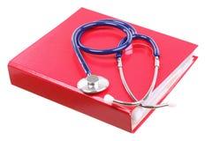 Blue stethoscope isolated on white. Blue stethoscope healthcare, instrument, isolated on white, red file folder, binder royalty free stock image