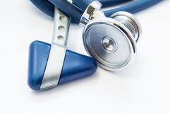 Blue stethoscope and neurological hammer closeup on white background as medical tool for preparation or conduct physical examinati. On of patient by physician Royalty Free Stock Photo