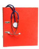 Blue stethoscope and red binder isolated on white Royalty Free Stock Photography