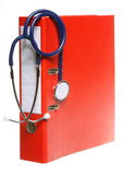 Blue stethoscope and red binder isolated on white. Healthcare, blue stethoscope and red file folder isolated on white royalty free stock image