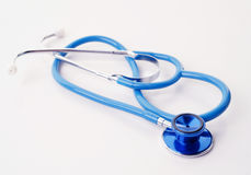 Blue stethoscope on white Royalty Free Stock Photos