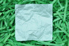 Blue sticky note on shredded paper Royalty Free Stock Images
