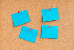 Blue sticky notes on cork board Royalty Free Stock Images