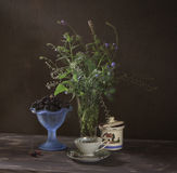 Blue Still Life. With blue dishes, sugar-bowl, forget-me-not and blueberries royalty free stock photography