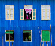 Blue Stilt house. Windows on a blue pile dwelling in Burma (Myanmar royalty free stock photography