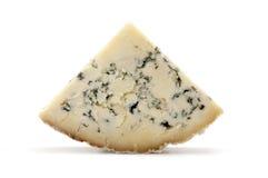 Blue Stilton cheese. Slice of blue Stilton cheese on a white background stock photos