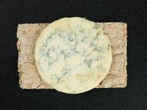 Blue Stilton Cheese on Thin Crisp Wholewheat Crackers Stock Images
