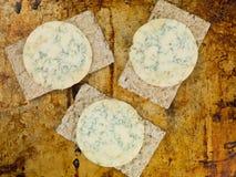 Blue Stilton Cheese on Thin Crisp Wholewheat Crackers Stock Photo