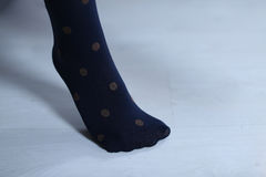 Blue stockings with dots Royalty Free Stock Photos