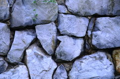Blue stone. Construct the wall in the garden Royalty Free Stock Photography
