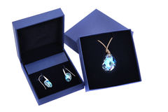 Blue stone pendant and earring in blue present box. Isolated Stock Images
