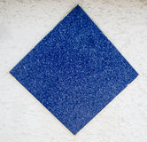 Blue stone square on rough white background Royalty Free Stock Images