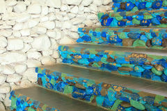 Blue stone stairs and white wall. For background stock photography